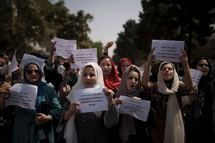 Afghan women march to demand their rights under the Taliban rule during a demonstration near the former Women's Affairs Ministry building in Kabul, Afghanistan on Sunday.