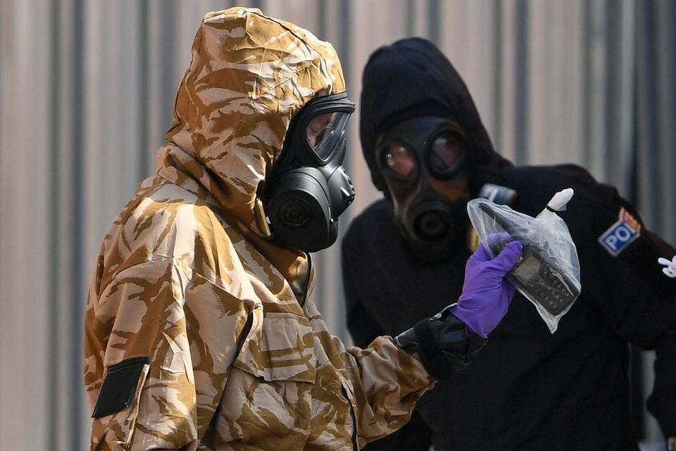 Investigators in protective suits looking into the poisoning in