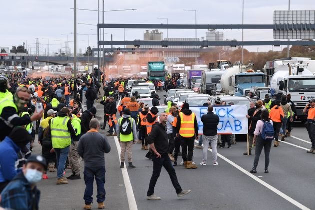 Construction workers and far right activists protest against Covid