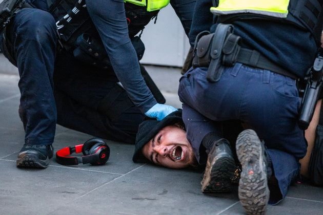 Victoria police arrest a protester during an anti vaccine protest on September 21,