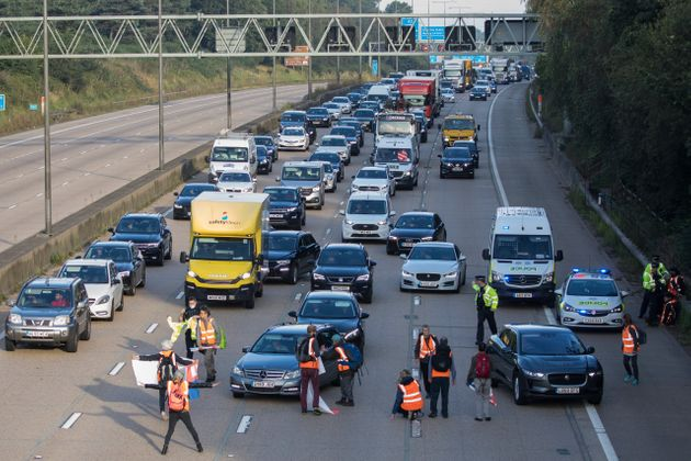 Insulate Britain climate activists begin to block the anticlockwise carriageway of the M25 between Junctions...