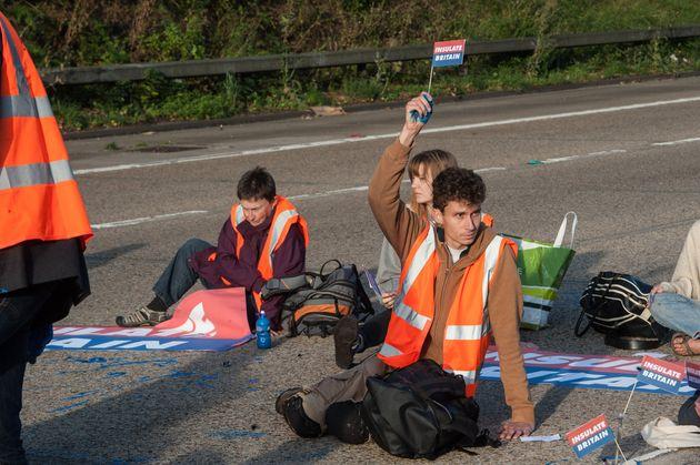 Protestors from Insulate Britain block the M25 motorway near Cobham in