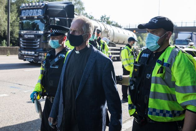 Insulate Britain climate activist Reverend Tim Hewes is arrested by Surrey