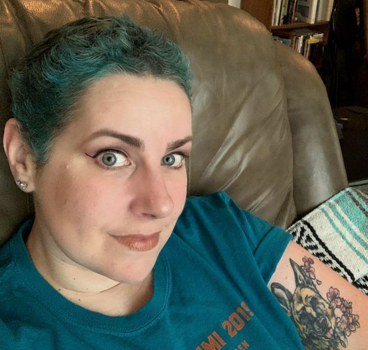 The author dyed her hair teal as it grew out after chemotherapy.