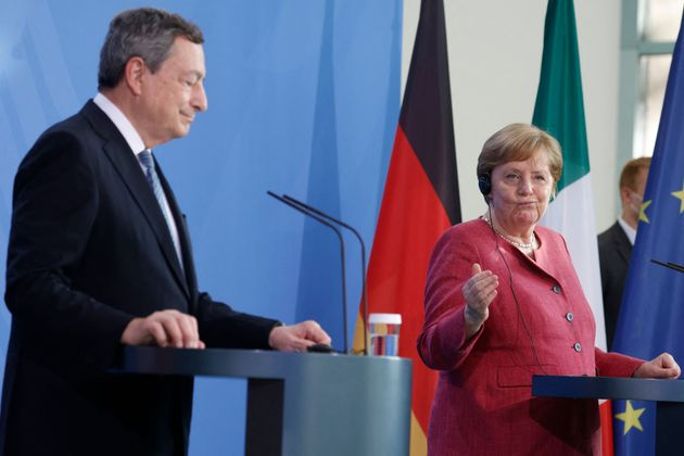German Chancellor Angela Merkel (R) and Italy's Prime Minister Mario Draghi give a press conference after...