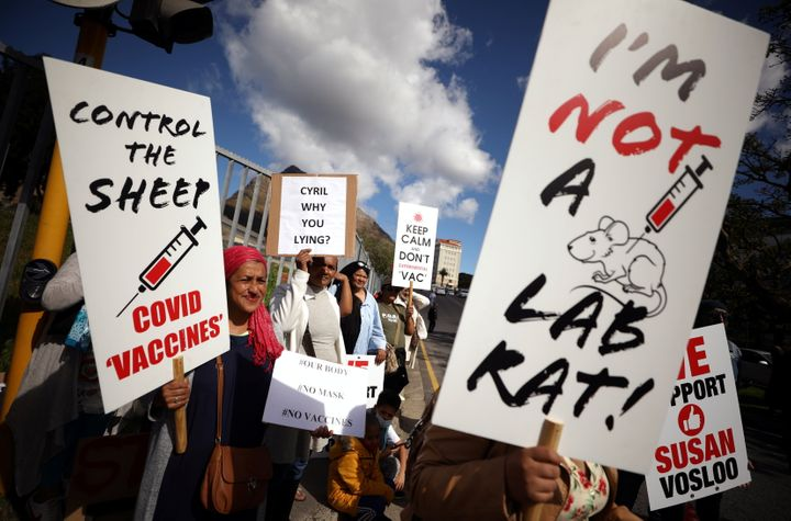 Anti-vaccine protestors hold placards a day after the country opened COVID-19 vaccinations for everyone 18 years old and above, outside Groote Schuur hospital in Cape Town, South Africa, on Aug. 21, 2021.