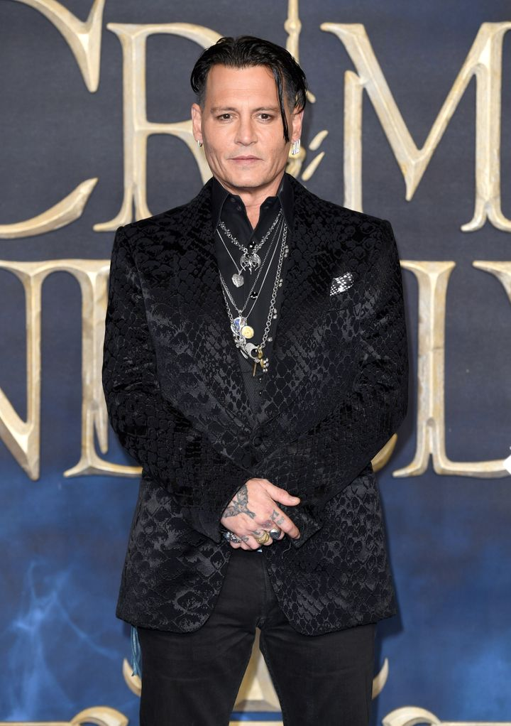 """Johnny Depp attends the UK Premiere of """"Fantastic Beasts: The Crimes Of Grindelwald."""""""