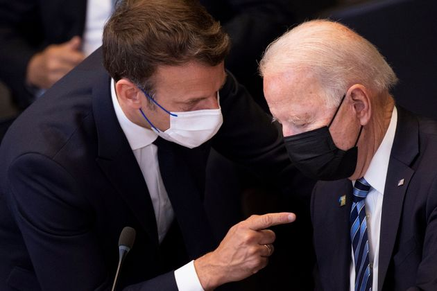 FILE - In this June 14, 2021 file photo, U.S. President Joe Biden, right, speaks with French President...