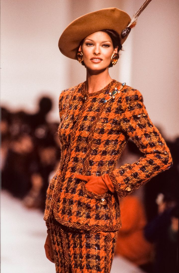 Linda Evangelista poses on the runway during a 1992 fashion show in Paris.