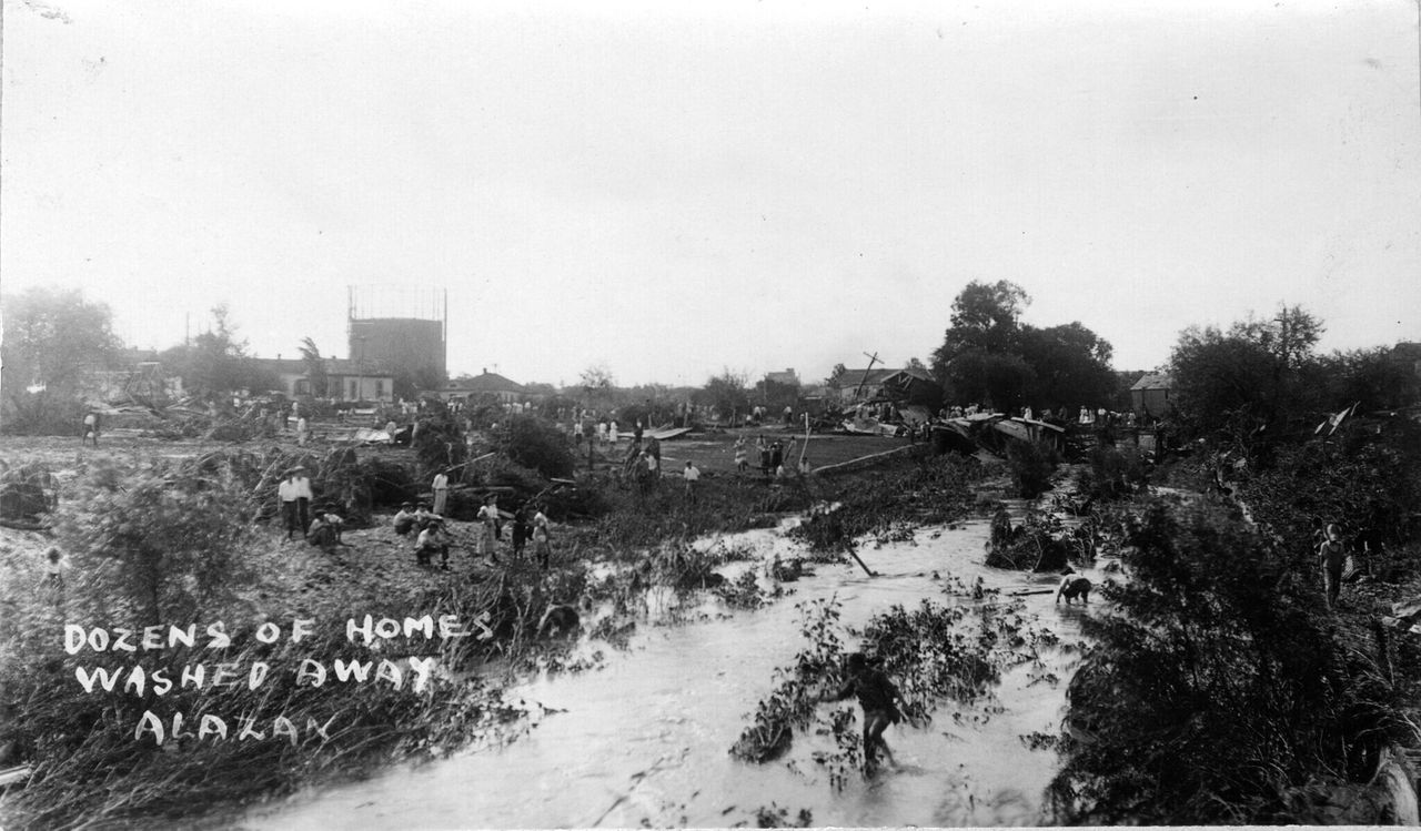 Photos from 1921 show dozens of homes washed away by the waters.