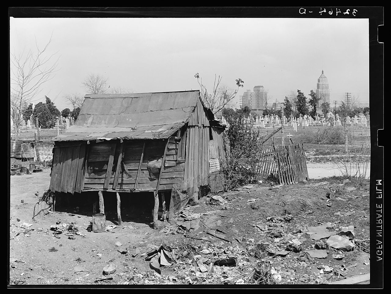 The type of the simple wooden homes Latinos on the west side of the city lived in. Many were instantly destroyed when the waters came.