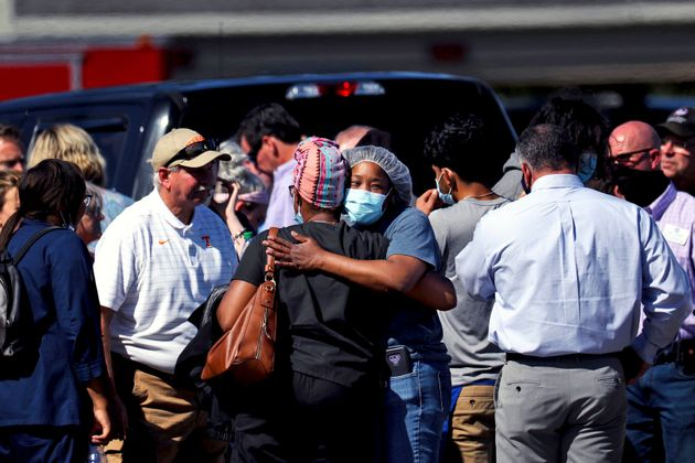 People embrace following a shooting at a Kroger grocery store in Collierville, Tennessee, on Thursday.