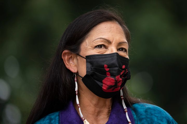 WASHINGTON, DC - JULY 29: Secretary of the Interior Deb Haaland prepares to take the stage during a welcome ceremony for a totem pole carved by the House of Tears Carvers of the Lummi Nation, on the National Mall July 29, 2021 in Washington, DC. The 25-foot totem pole was cut and hand-carved from a 400-year old Western red cedar tree. The House of Tears Carvers of the Lummi Nation transported the totem pole from Washington state to Washington, DC. (Photo by Drew Angerer/Getty Images)