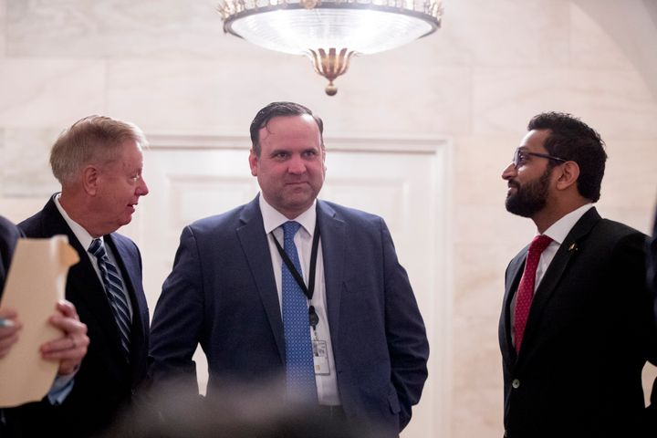 From left, Sen. Lindsey Graham (R-S.C.), White House social media director Dan Scavino, and National Security Council Senior Director of Counterterrorism Kash Patel outside the Diplomatic Room as then-President Donald Trump speaks at the White House on Oct. 27, 2019.