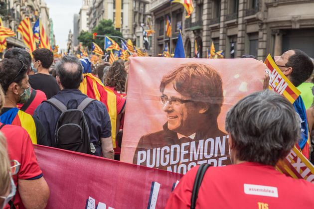 Protester is seen with a flag with the face of Carles Puigdemont, former president of the Generalitat of Catalonia. On the day that the traditional Diada de Catalunya 2021, National Day of Catalonia is celebrated, a large demonstration for independence with more than 400,000 people has been held in Barcelona. Some protesters at the end of the demonstration have had conflict with the police. (Photo by DAX Images/NurPhoto via Getty Images)