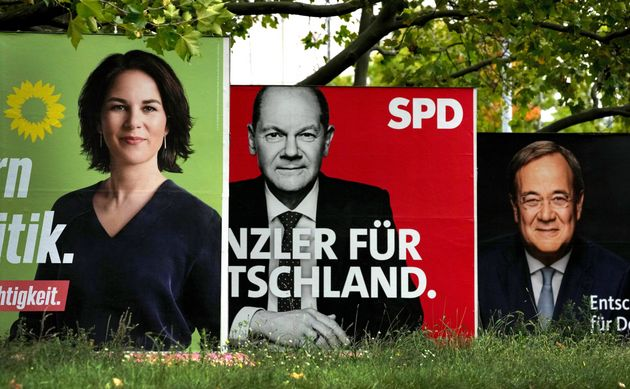three elections posters show top candidate for chancellor of the Greens Annalena Baerbock, left, Social...