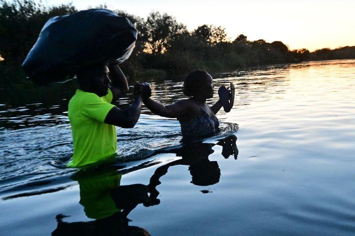 Haitian migrants cross the Rio Grande at the Mexico-U.S. border near Ciudad Acuna in Mexico — across the Rio Grande from Del Rio, Texas — on Thursday.