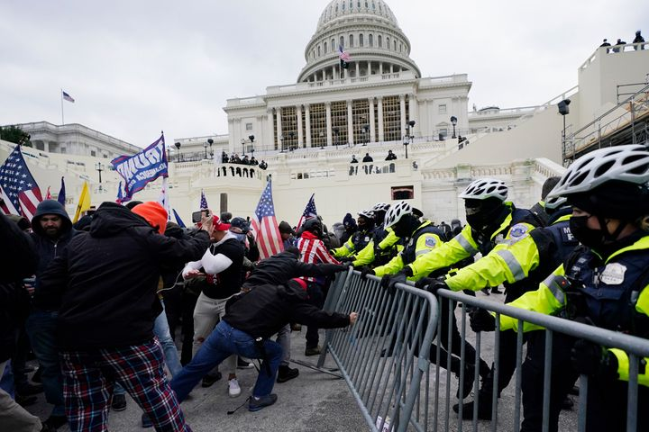 """Donald Trump supporters try to break through a police barrier at the U.S. Capitol on Jan. 6. The former president has said he would use """"Executive Privilege"""" to fight subpoenas in the House investigation of the riot."""