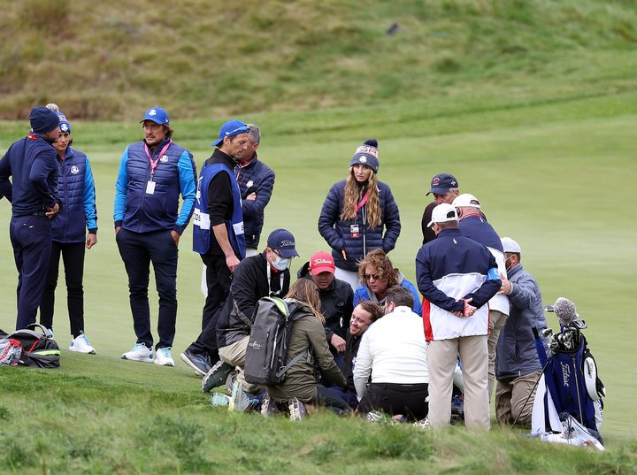 People surround Tom Felton after he collapsed during the celebrity golf matches ahead of the 43rd Ryder Cup at the Whistling Straits course in Wisconsin.