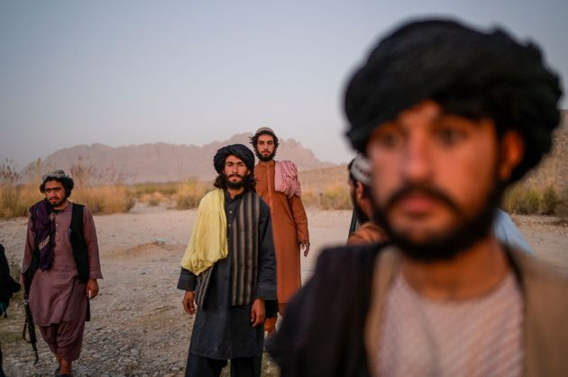 In this picture taken on September 23, 2021, Taliban members enjoy an afternoon on the banks of a river...