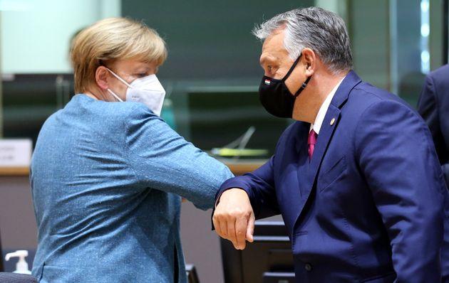 BRUSSELS, BELGIUM - OCTOBER 01: Hungary's Prime Minister Viktor Orban and German Chancellor Angela Merkel...