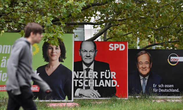 Billboards with election campaign posters showing the three chancellor candidates in the the September...