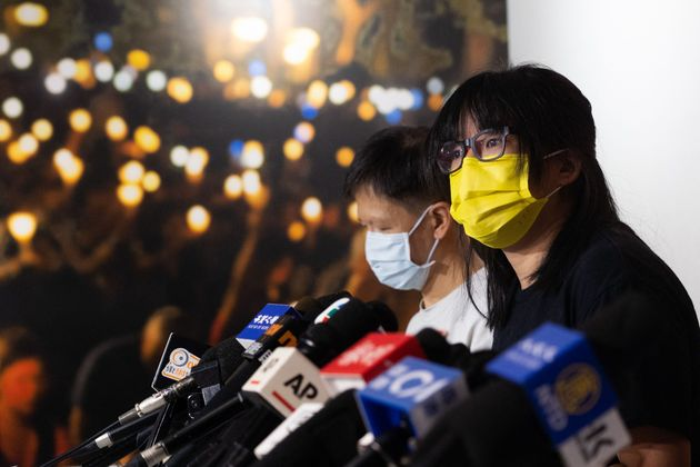 The Hong Kong Alliance in Support of Patriotic Democratic Movements of China member Chow Hang-tung (R)...