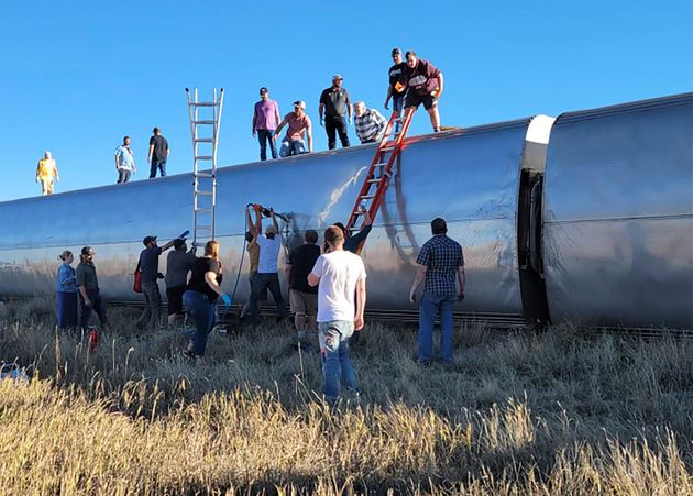 People work at the scene of an Amtrak train derailment on Saturday in north-central Montana. Multiple...