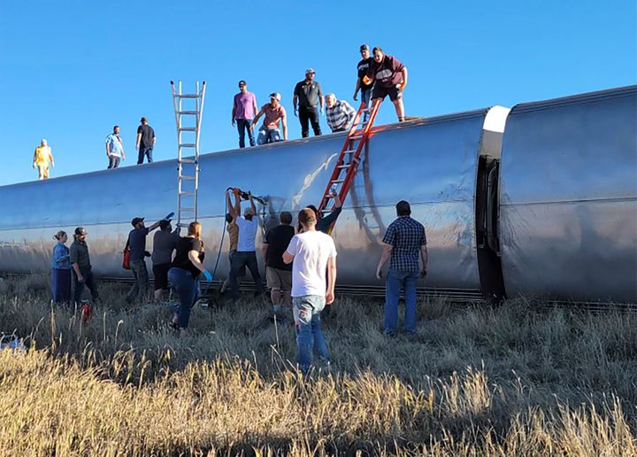 People work at the scene of an Amtrak train derailment on Saturday in north-central Montana. Multiple people were injured when the train that runs between Seattle and Chicago derailed Saturday, the train agency said.