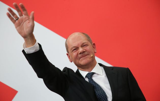 26 September 2021, Berlin: Olaf Scholz, Finance Minister and SPD candidate for Chancellor, waves during...