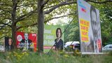 From left to right, election posters of the CDU/CSU with Armin Laschet, the SPD with Olaf Scholz, Bündnis 90/Die Grünen with Annalena Baerbock and the FDP with Christian Lindner are lined up in Berlin one day after the Bundestag elections.