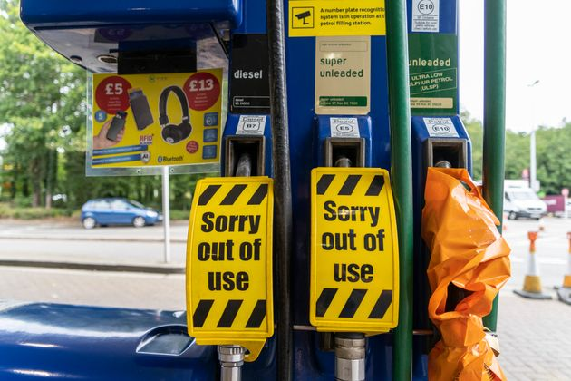 'Sorry out of use' signs at a petrol station in Bury St