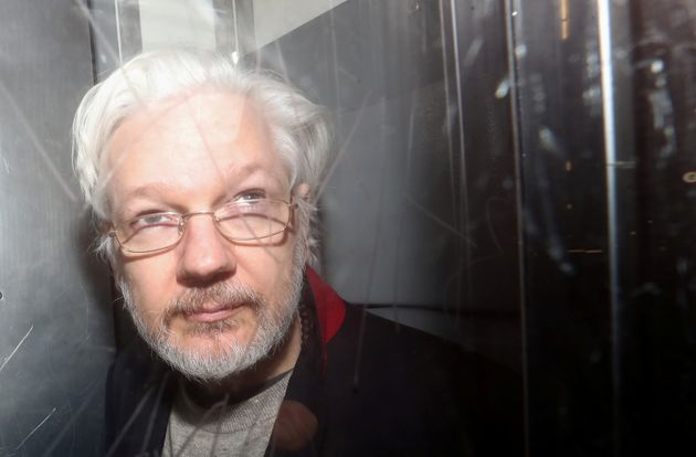 WikiLeaks' founder Julian Assange leaves Westminster Magistrates Court in London, Britain January 13,...