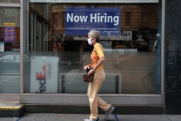 A hiring sign is displayed in a store window in Manhattan on Aug. 19 in New York City.