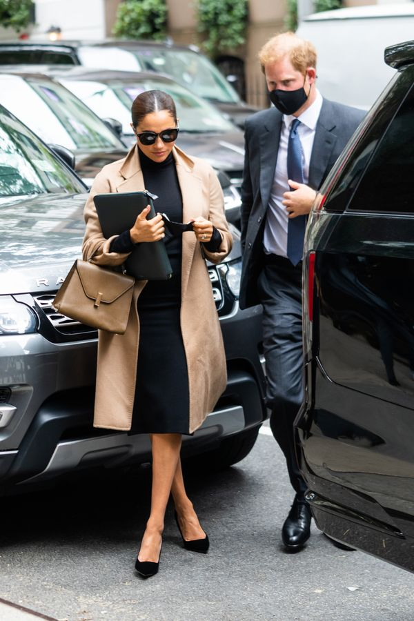 Meghan and Harry are seen arriving at the offices of the World Health Organization in Midtown Manhattan on Thursday.