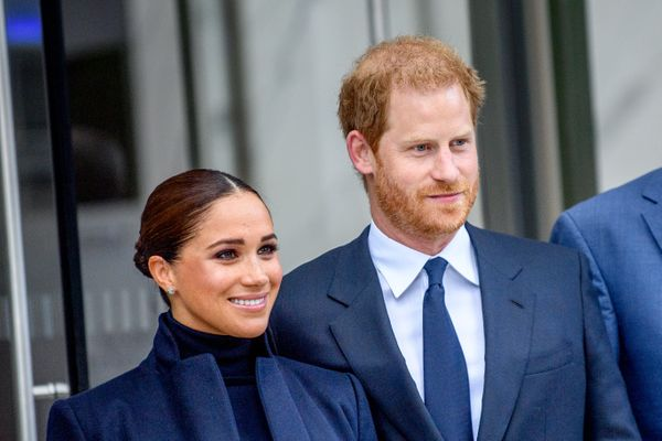 Meghan and Harry smile for the cameras.