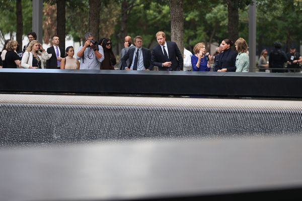 Harry and Meghan observe the grounds of the Sept. 11 memorial.