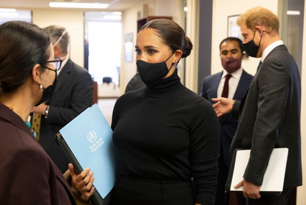 Harry and Meghan speak with leaders after their joint roundtable with WHO.