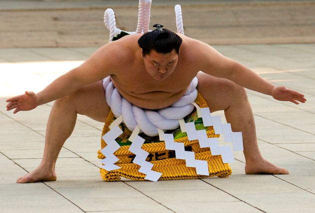 Mongolian-born grand sumo champion Yokozuna Hakuho performs the New Year's ring-entering rite at the...