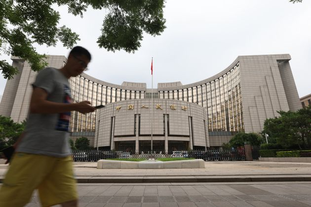 BEIJING, CHINA - JULY 20: A man walks past the People's Bank of China (PBOC) building on July 20, 2021...