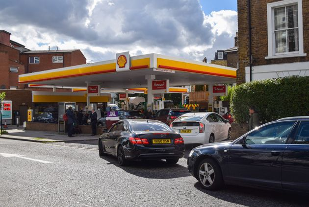 Cars queuing outside a Shell station in