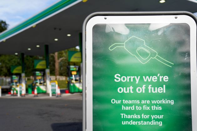 A sign outside a BP petrol station in Birmingham informing people that there is no fuel. Picture date:...