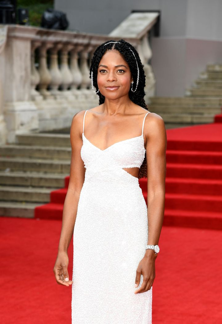 Naomie Harris in an ethereal gown with side cutouts and major ear jewelry.