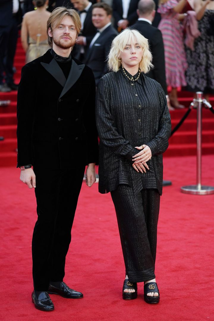 Finneas O'Connell and Billie Eilish walk the red carpet.