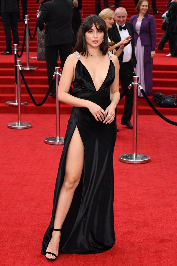 Ana de Armas pulls an Angelina Jolie with her red carpet pose.