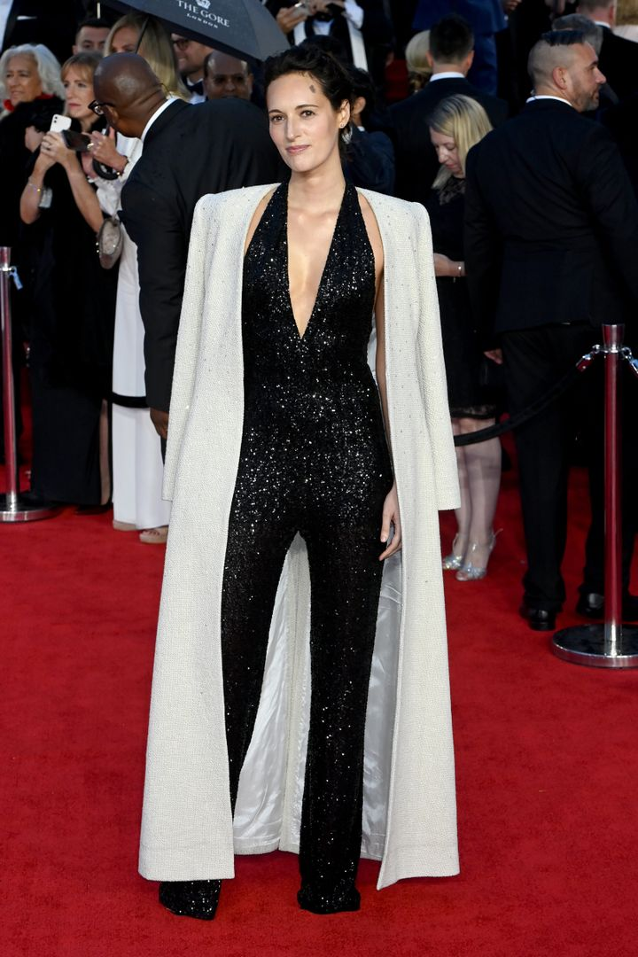 Phoebe Waller-Bridge dazzles in a beaded black jumpsuit with a glittering white cape.
