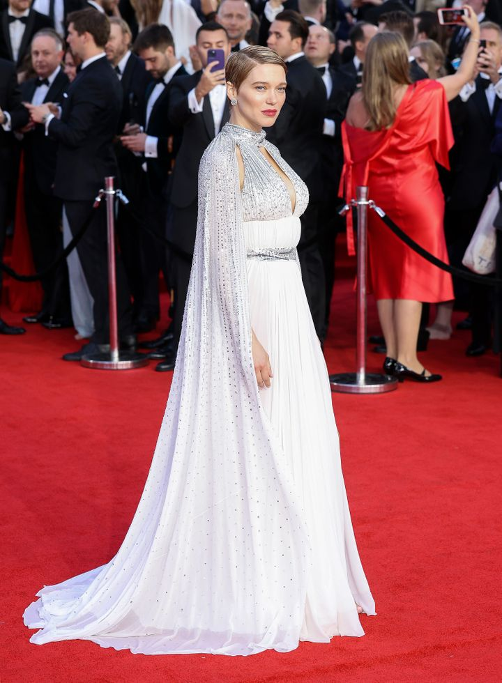 Léa Seydoux in a caped white dress with silver detailing.