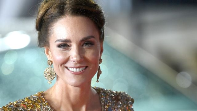 Kate Middleton Dazzles In A Glittering Gold Gown At The James Bond Premiere.jpg