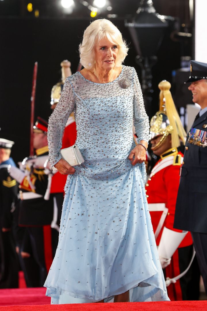 The Duchess of Cornwall paired her embellished gown with a white clutch.