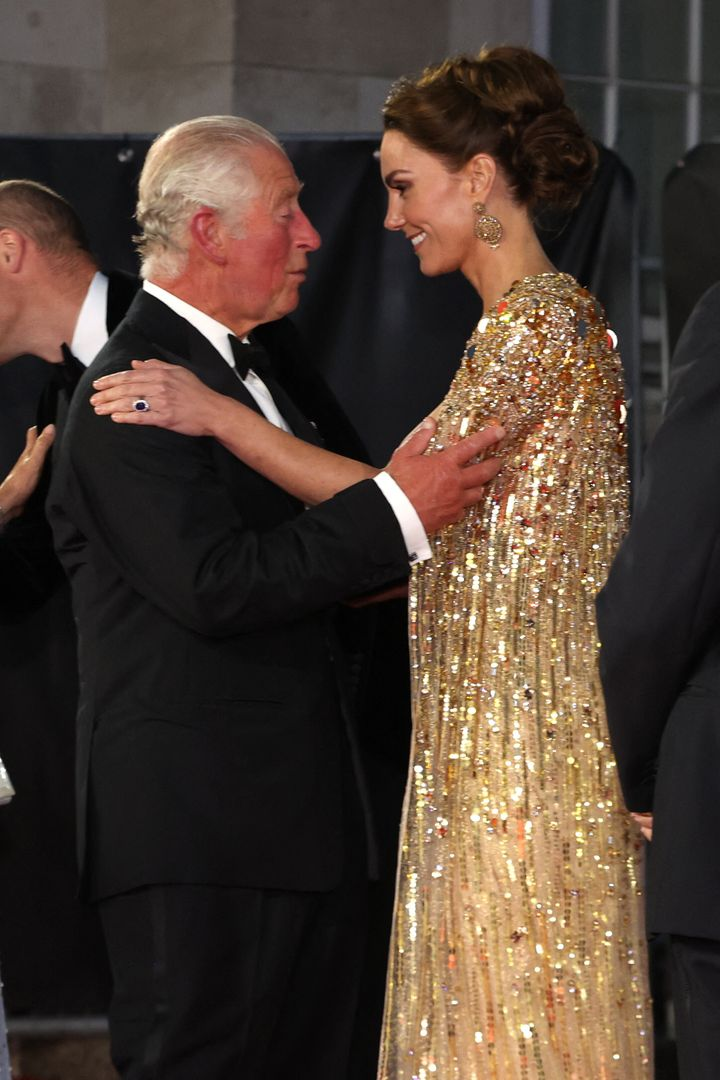 Charles and Kate greet each other on the red carpet.
